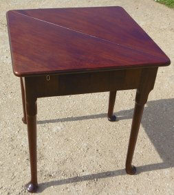 Open Corner Table showing escutcheon for lockable storage area underneath main flap.